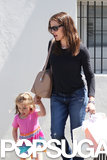 Jennifer Garner juggled shopping bags while holding Seraphina Affleck's hand in LA.