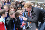 Prince Harry Turns Up the Charm and Puts on the Gloves During Sweet Royal Visits