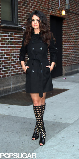 Selena Gomez wore a short black trench coat leaving her appearance on the Late Show.