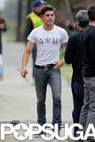 Zac Efron wore a tight t-shirt on the Townies set.