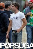 Zac Efron rocked a tight t-shirt and a tattoo on the set of Townies.