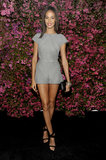 Joan Smalls put her long legs on display in a gray romper, accented with chic black ankle-strap pumps and a black clutch.