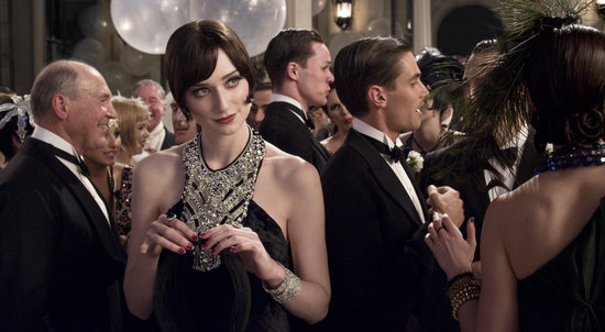 Elizabeth Debicki as Jordan Baker looks ultraglam with a decadent, jeweled neckline and the quintessential '20s coif.