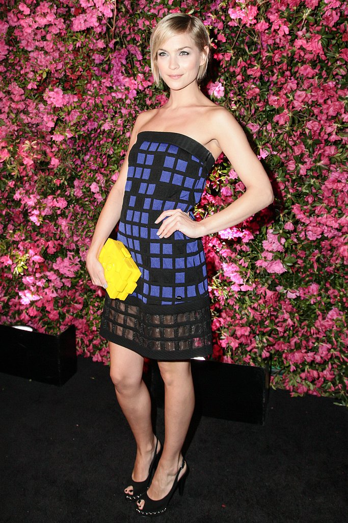 Leigh Lezark popped in a strapless blue-and-black Chanel dress, a bright yellow Chanel clutch, and pearl-accented peep-toes.  Matteo Prandoni/BFAnyc.com