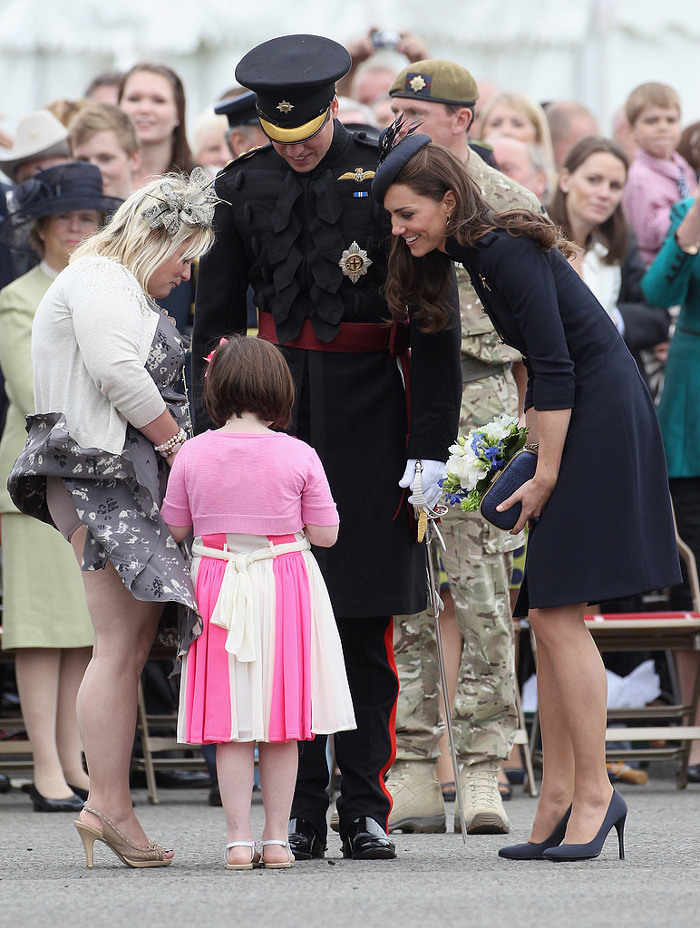Prince William and Kate Middleton showered a young fan with attention at the Irish Guards Medal Parade in Windsor, England, in June 2011.
