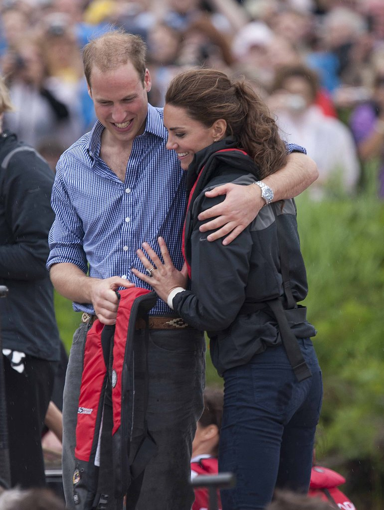 Prince William wrapped his arm around Kate Middleton in Charlottetown, Prince Edward Island, in July 2011.