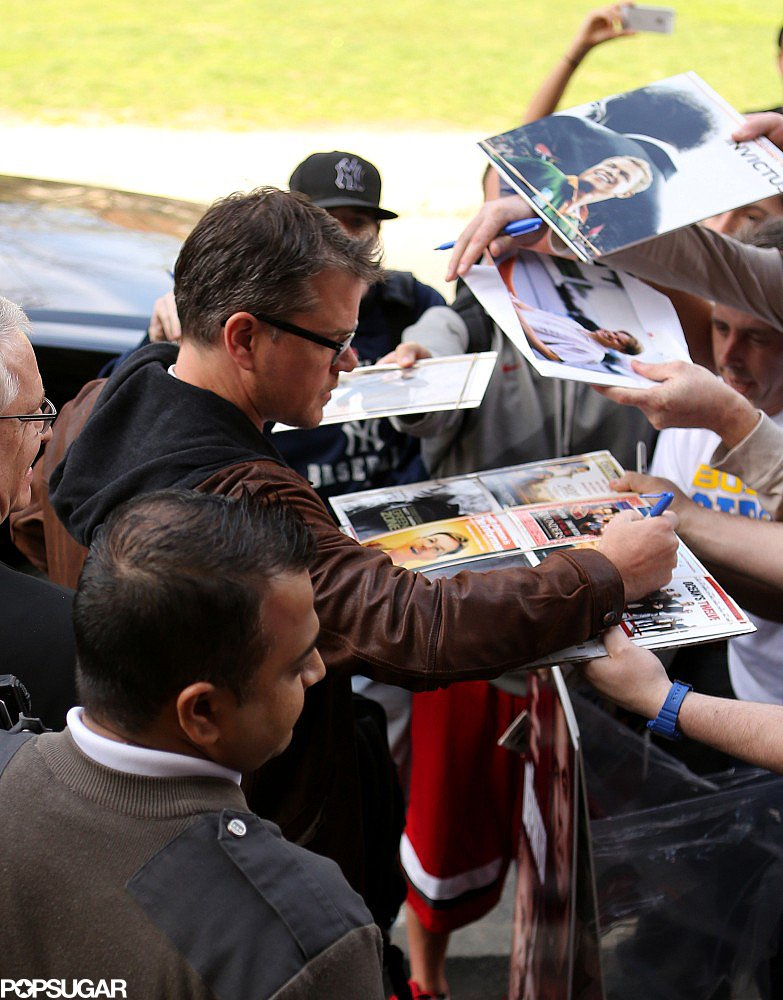 Matt Damon signed autographs before heading into Harvard University, where he was awarded the 2013 Harvard Arts Medal.
