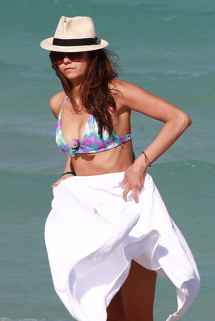 Nina Dobrev covered up with a towel in Miami on Friday.