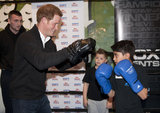 Prince Harry put his mitts up for a boxing match with kids from Nottingham's KK Boxing Club on April 25.