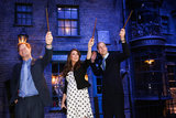 Kate Middleton, Prince Harry, and Prince William got goofy with wands during a visit to Leavesden Studios.