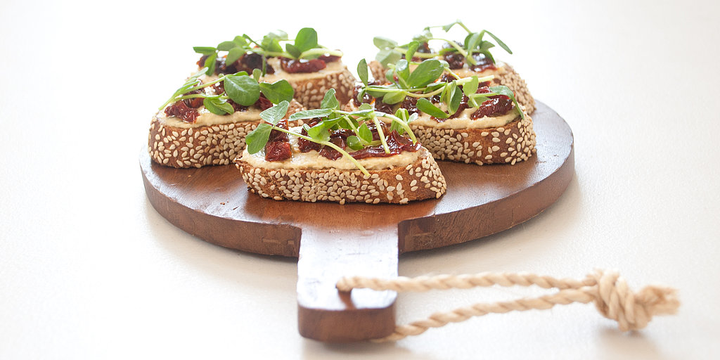 Killer App: Hummus, Sun-Dried Tomato, and Pea Shoot Crostini
