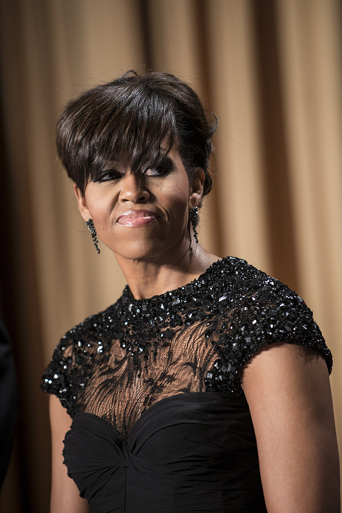 We might only be able to see a hint of Michelle Obama's embellished black Monique Lhuillier gown, but we can already tell that it's stunning.