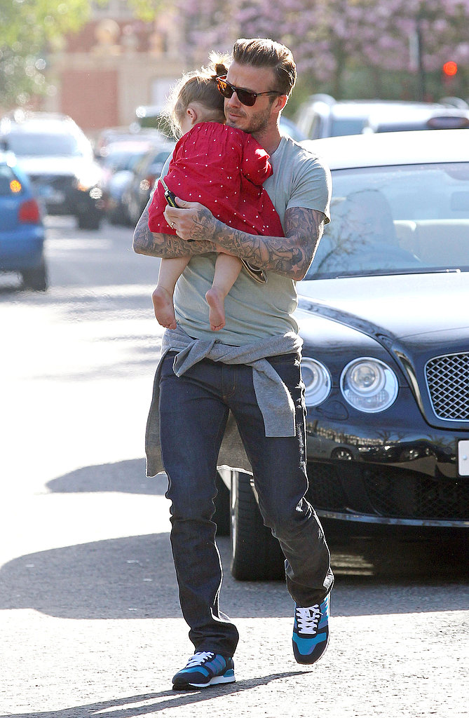 David Beckham carried Harper Beckham today.