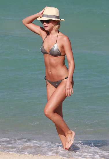 What better way to capitalize on beachy glamour than in a sparkly suit like Julianne Hough.  Get the look: Melissa Odabash Mirella Bikini Set ($89, originally $184)