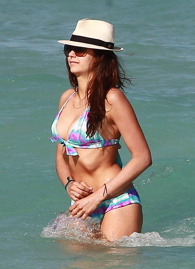 Nina chose a cool, color-washed suit for a dip in the ocean. Get the look: Victoria's Secret Beach Sexy Push-Up Halter Top in purple tie-dye ($27) Victoria's Secret Beach Sexy Cheeky Hipkini Bottom in purple tie-dye ($19)