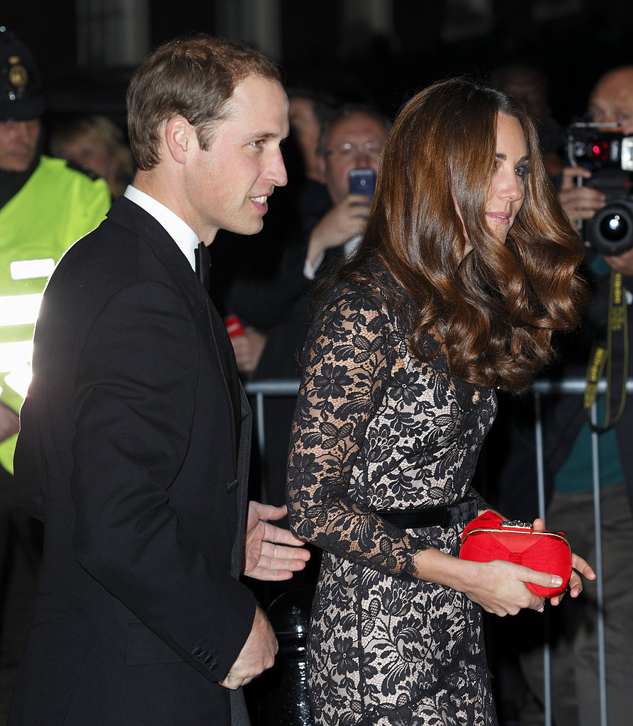 The couple attended a University of St. Andrews dinner in style — with Kate wearing a lacy Alice Temperley gown and red clutch.