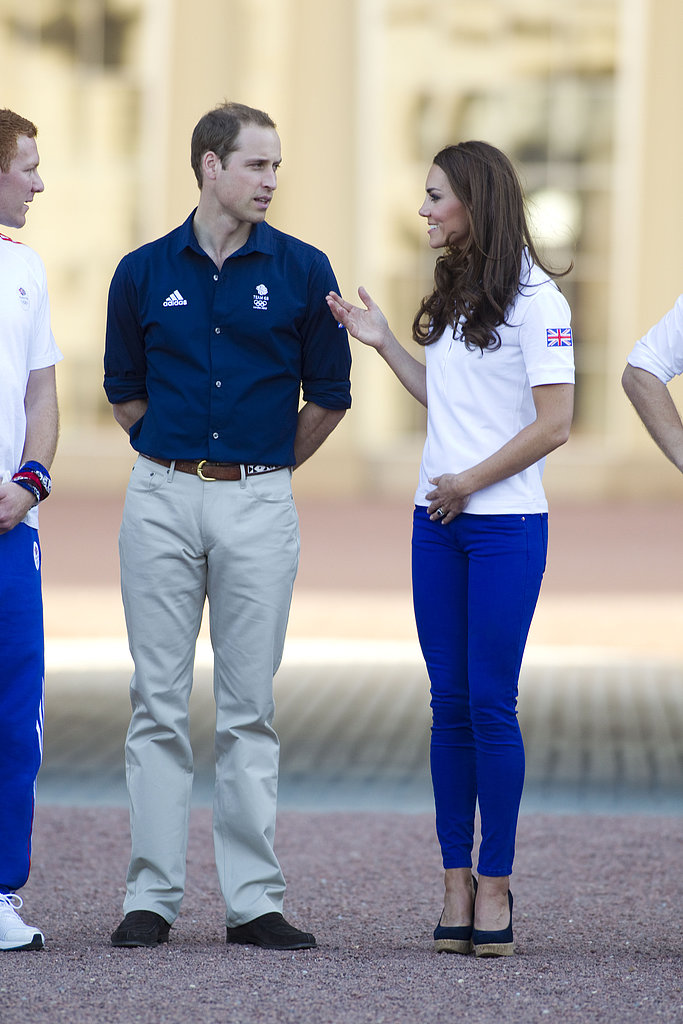 The royal couple coordinated in blues and sportier attire to watch the Olympic torch arrive at Buckingham Palace.