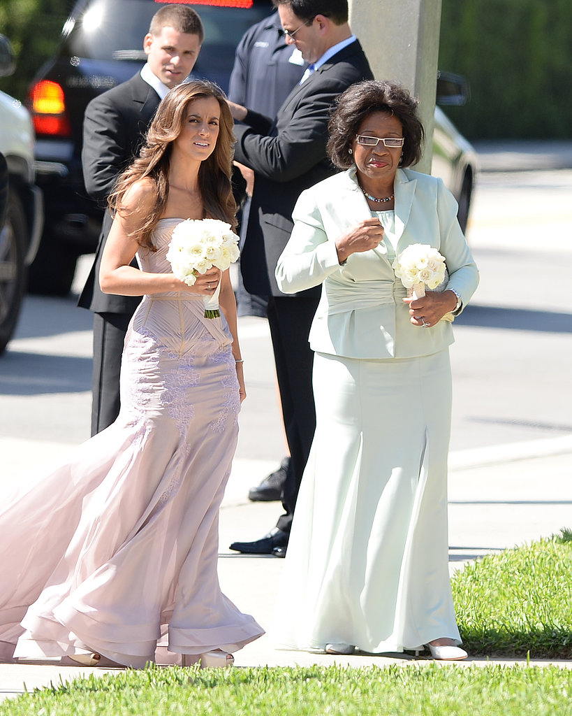 Michael Jordan's mum, Deloris, walked into the church with a bridesmaid.
