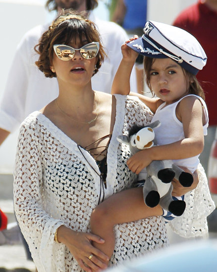 Kourtney Kardashian carried her little Grecian sailor while vacationing with her family in Santorini.