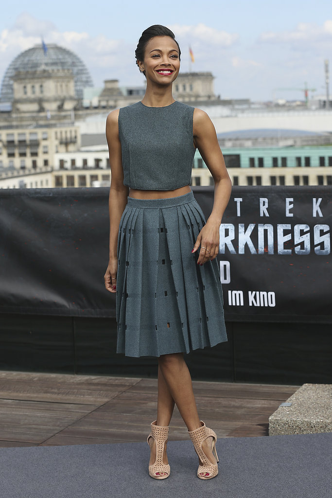 Zoe Saldana showed off a hint of skin via a grey crop top and pleated (and perforated) Calvin Klein combo, which she accessorised with nude Jimmy Choo sandals.