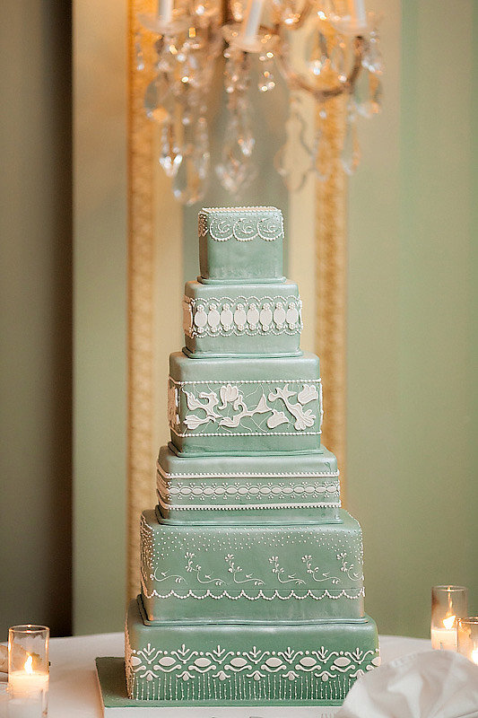 Six tiers are just enough to capture all the gorgeous details of this cake — the color stands out for good reason, and the lace-like icing is a delicate, classic touch.  Photo by The Youngrens via Style Me Pretty
