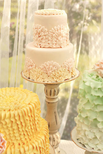Typical ruffle cakes get an upgrade with fun colors and an appliqué-like pattern.   Photo by Jessica Zais Photography via Green Wedding Shoes