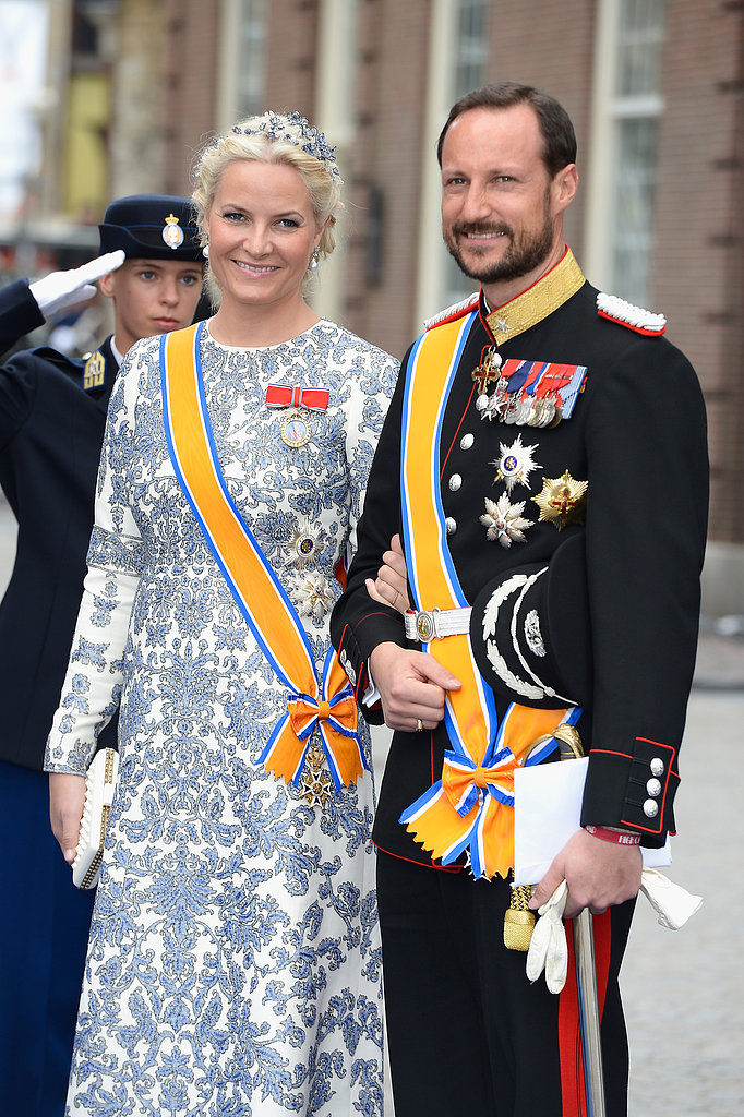 Crown Prince Haakon and Crown Princess Mette-Marit of Norway stood together.