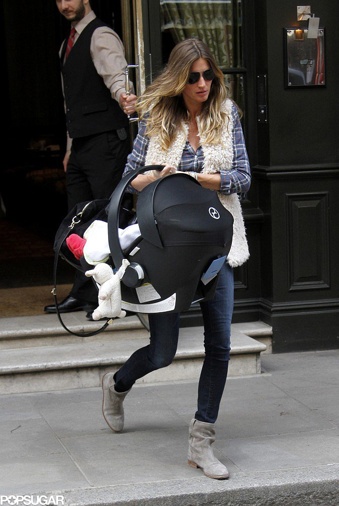 Gisele Bündchen carried her daughter Vivian Brady on Tuesday.