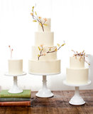 Basic cakes are anything but boring when they are topped with lovely branches like these.  Photo by Jen Huang Photography via Style Me Pretty