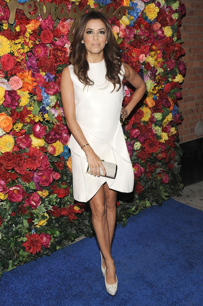 The sculptural shape on the white dress Eva Longoria donned at a Ferragamo party in NYC gave her look a totally fashion-forward feel. Then a pair of white studded pumps added just the right amount of edge.