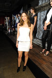 Katharine McPhee attended Alice + Olivia's Fall 2013 presentation in NYC wearing a white peplum dress by the label, complete with cool black booties.