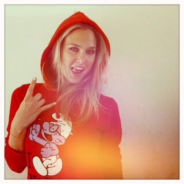 Bar Refaeli flashed a peace sign in a red Smurfs hoodie. Source: Instagram user barrefaeli