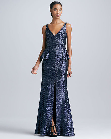 The attached peplum and sequined satin are pure glamour on this Carmen Marc Valvo gown ($895). We like the sexy details of the plunging neckline and front slit. You can imagine how this will move beautifully on the dance floor.