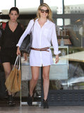 Ali Larter got her shopping on in a crisp white shirtdress, which she punched up via a brown double belt and Rag & Bone booties.