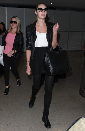 Candice Swanepoel was on trend while arriving at LAX airport in a black and white dress topped with a black leather jacket.