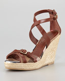 Burberry's wedge espadrille ($350) takes a more classic route with its supple leather and plaid detailing.