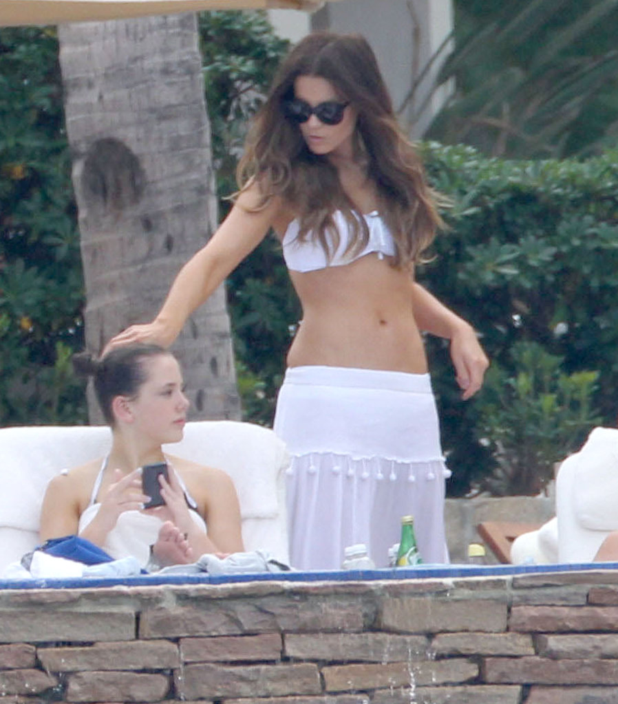 Kate Beckinsale and her daughter Lily lounged poolside during a March 2013 trip to Mexico.