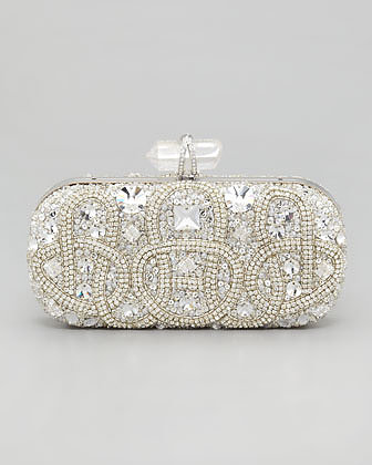 If there's a quintessential bridal clutch, you're looking at it. Between the crystal and glittering pavé details, Marchesa's embroidered stone box clutch ($3,295) is a bride's dream.