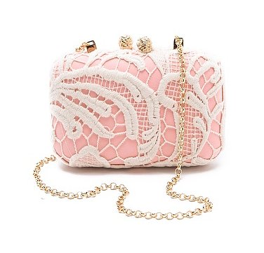 Why not add a little feminine pink to your bridal style via this Kotur lace minaudiere ($450)? It's undeniably pretty, especially with the lace overlay.