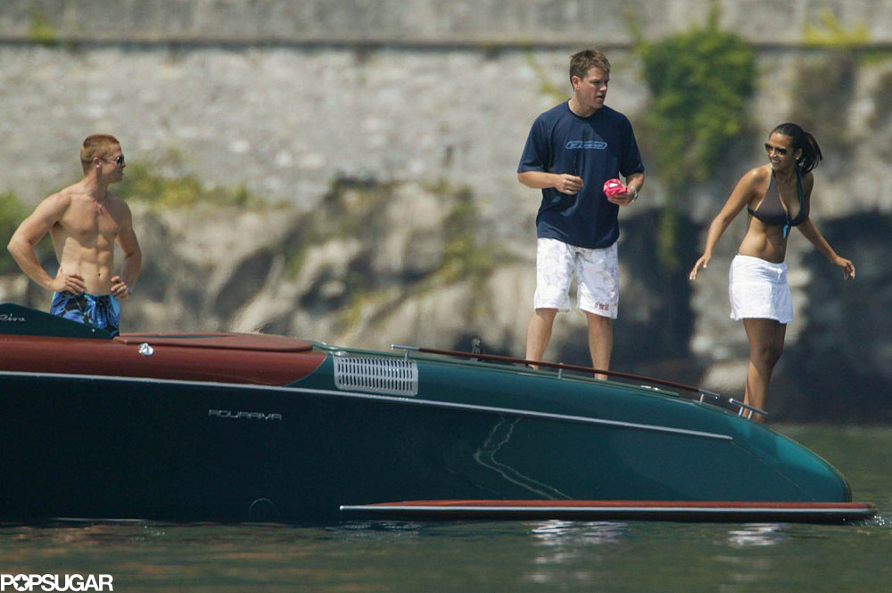 Brad Pitt flashed his abs while boating with Matt Damon and Luciana Barroso on Lake Como in June 2004.