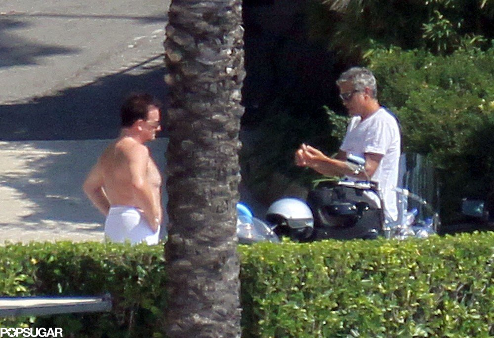 Bono and George Clooney chatted while vacationing together at his Lake Como residence in August 2011.