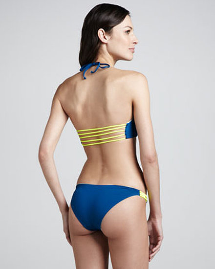 The front of this Basta Surf Halter ($198) looks like any typical bikini with lines perfect for tanning. But as you can see, there are five bright straps across the back to keep you feeling confident when you're in the water.