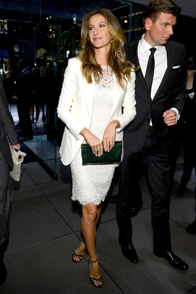 Gisele Bündchen attended the Dolce & Gabbana Fifth Avenue flagship opening in a slick white blazer and girlier lace LWD. To finish, she added a green clutch and simple black sandals.