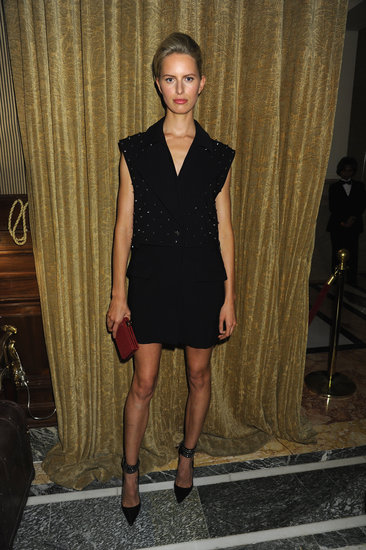While Karolína Kurková's black shift and red clutch didn't prove too punk, her slicked-back hair added the requisite edge at the Moda Operandi party.