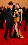 Constance Jablonski flashed a little leg in her gold Wes Gordon gown as her designer date gave a sexy glare.