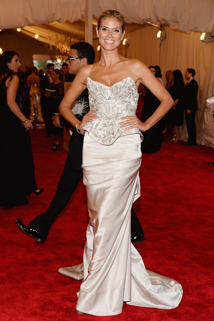 Heidi Klum showed off her décolletage in a metallic bustier embroidered gown by Marchesa and Harry Winston jewels.