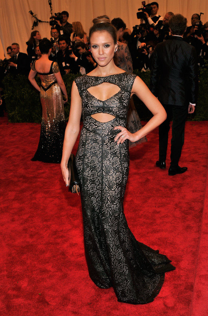 Jessica Alba's laser-cut Tory Burch leather gown featured strategically-placed cut-outs.