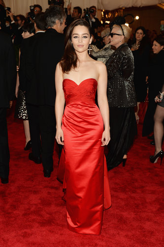 Emilia Clarke was vibrant in a red strapless Ralph Lauren gown with a sweetheart neckline and a single Fred Leighton cross earring.