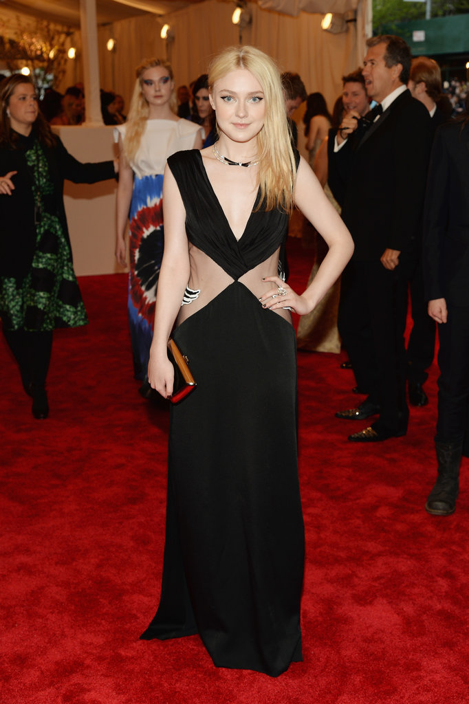 Dakota Fanning showed a bit of skin in a black sheer plunging Rodarte gown.