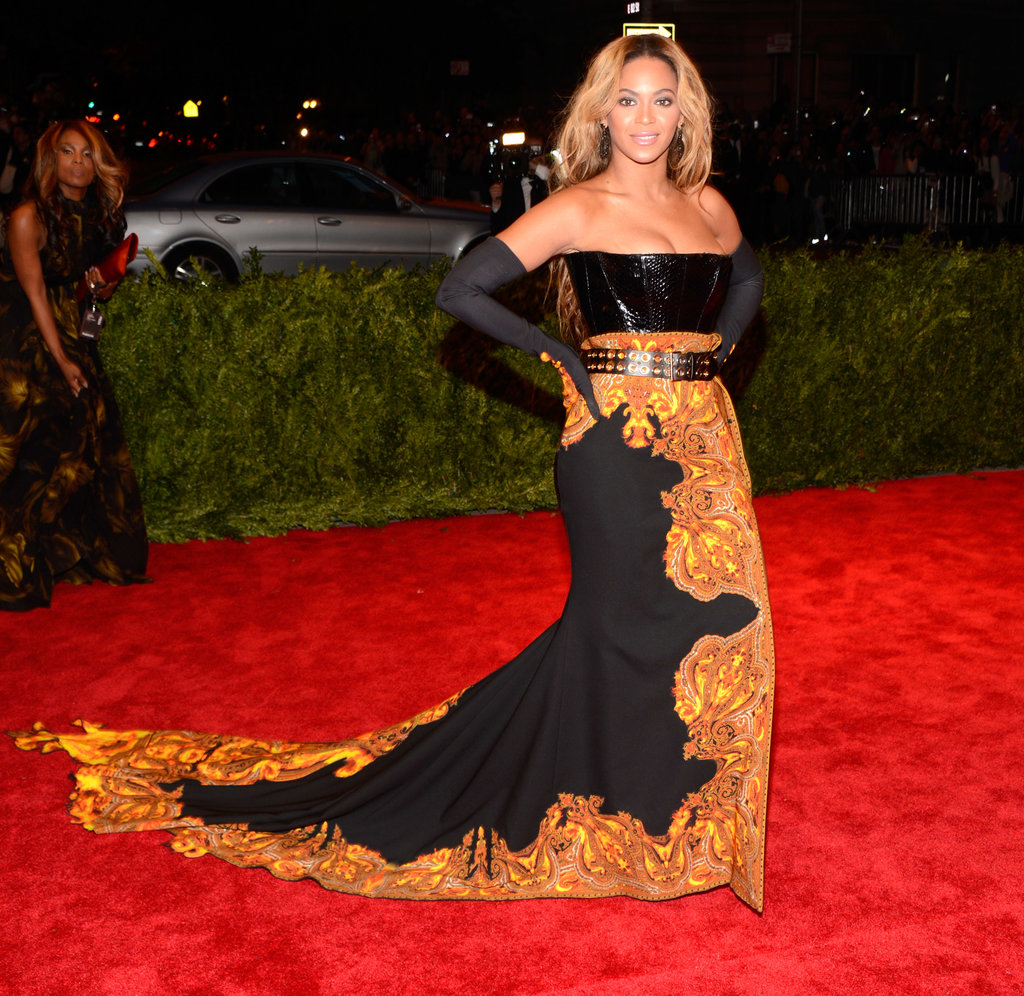Beyoncé posed with her drama-inducing, flame-embroidered train trailing behind her.